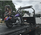 Motorcycle on flatbed.